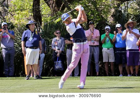 PONTE VEDRA BEACH, FLORIDA - MAR 14: Rickie Fowler tees off during the first round of The PLAYERS Championship on The Stadium Course at TPC Sawgrass on March 14, 2019 in Ponte Vedra Beach, Florida.