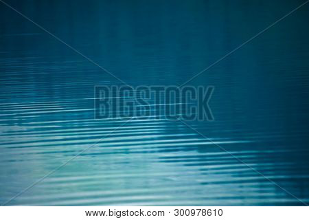 Amazing Textured Background Of Calm Blue Clean Water Surface. Sunshine In Mountain Lake Close-up. Be