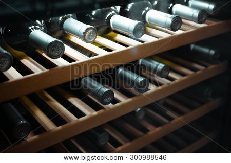 Storing Bottles Of Wine In Fridge. Alcoholic Card In Restaurant. Cooling And Preserving Wine.
