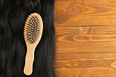 Long black hair and wooden hairbrush. Hair care poster