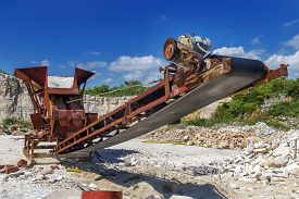 Old Rusty Stone Crushing Machine In Abandoned Quarry