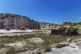 Old Abandoned Quarry Site With Equipment And Machine