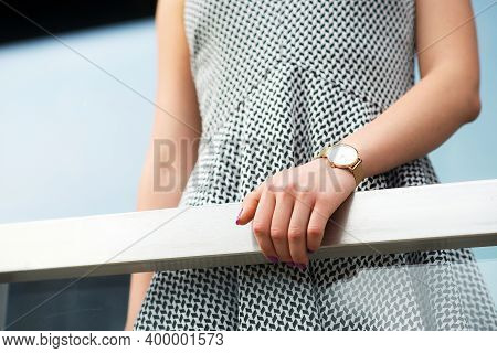 Womans Hand With A Clock, Close-up. Fashionable Summer Womens Outfit, Elegant Wrist Watch On A Hand