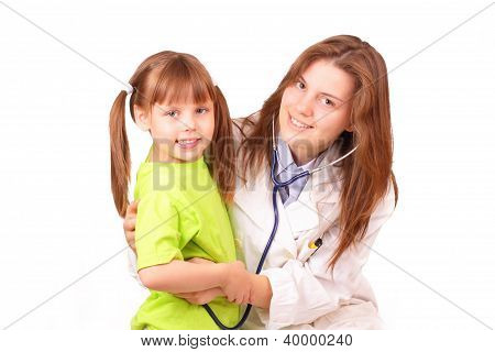 Young Medical Doctor Woman Inspects Beautiful Little Girl