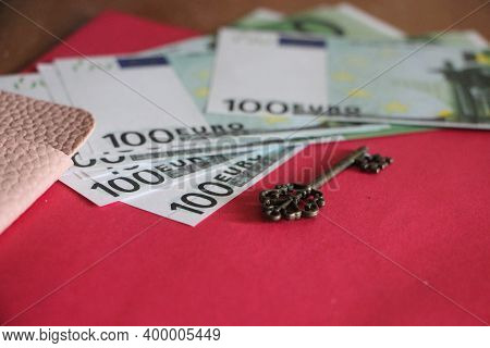 Key And 100 Euro Bills. Profitable Business Success. Key To Money Concept