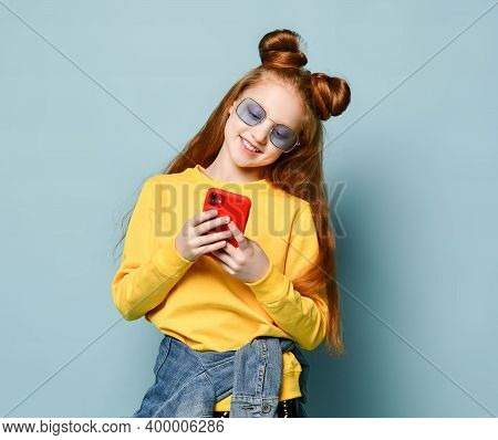 Photo Of Young Girl Kid Child Notification Received Looking Into Screen Of Telephone Cellphone Mobil
