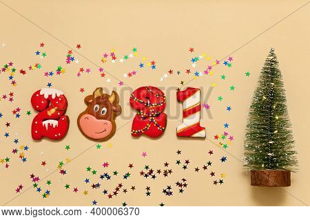 Numbers 2021 From Gingerbread Cookies In Multi-colored Glaze On A Beige Background. The Symbol Of Th