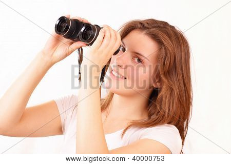 Happy Young Girl Watches Through Binoculars