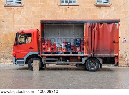 Llucmajor, Spain; December 17 2020: Red Beverage Delivery Truck Parked. Inside The Truck, Boxes Of S