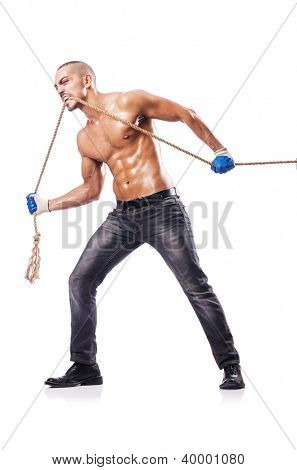 Muscular man pulling the rope