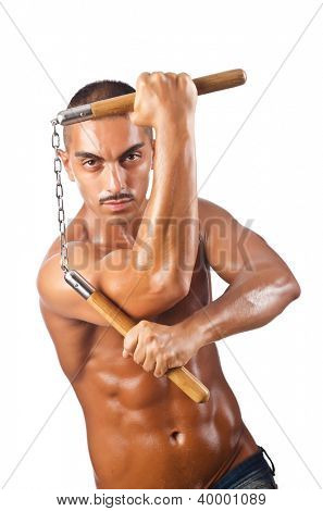 Man in martial arts concept with nunchucks