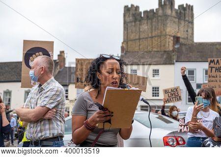 Richmond, North Yorkshire, Uk - June 14, 2020: A Black Woman Speaks At A Black Lives Matter Protest