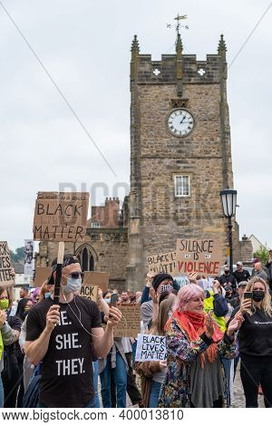 Richmond, North Yorkshire, Uk - June 14, 2020: Black Lives Matter Protesters Hold Banners In Front O