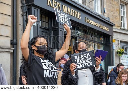 Richmond, North Yorkshire, Uk - June 14, 2020: A Powerful Black Woman Holds A Black Lives Matter Ban