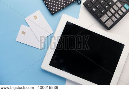 Top View Of Digital Tablet, Credit Cards With Office Suppliers On Table