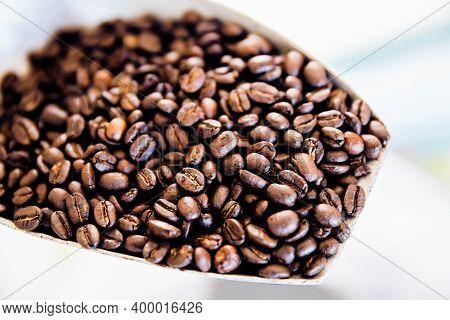 Macro Shot Coffee Beans Background. Close Up Coffee Beans. Freshly Roasted Dark Brown Arabica Coffee