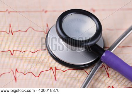 Medical Equipment Stethoscope Lying On Electrocardiogram Closeup. Diseases Of Cardiovascular System