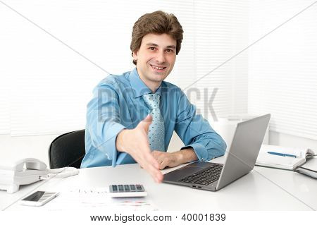 Businessman Working In The Office On A Laptop