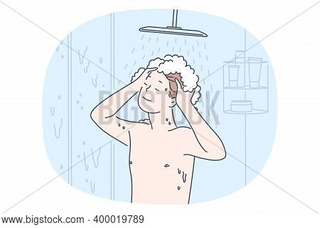 Taking Shower And Personal Hygiene Concept. Young Smiling Boy Enjoying Shampoo And Hot Water During