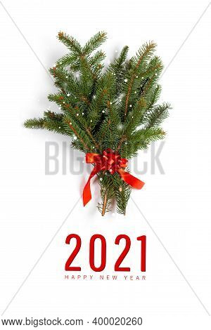 2021 Happy Holidays Greeting Card. Spruce Branch. Christmas Tree Pine Needles Decoration With Red Ri