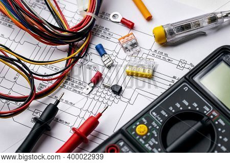 Electrician Tools And Electrical Equipment On Wiring Diagram