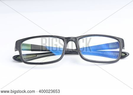 clear glasses with black frame on isolated white background. fashion and eye health products. sport