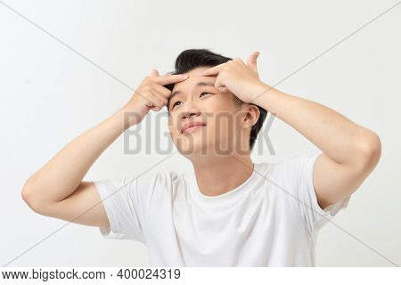 Acne Treatment. Acne Man Squeezing His Pimple, Removing Pimple From Him Face