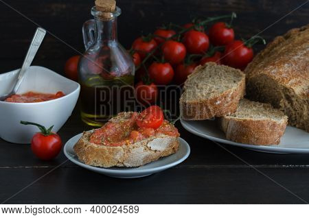 Popular Spanish Breakfast. Crusty Bread With Fresh Cherry Tomato And Olive Oil Is Typical Tapa  In S