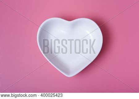 A Heart-shaped Saucer On A Rose Background.