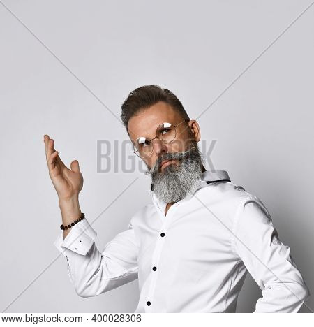 Confused Stylish Bearded Hipster Man In Eyewear Raising Sharing Thoughts Hand Looking Up. Handsome M