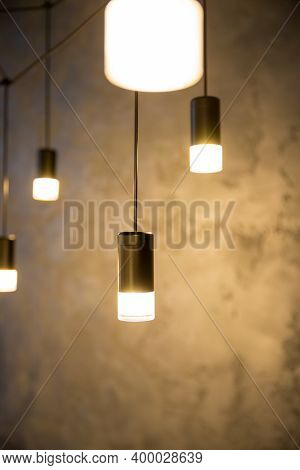 Hanging Retro Incandescent Lamp On A Background Of Wooden Blinds.creative Loft Style Lamp With Shini