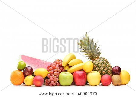 Pile of different fruits on a table isolated on white background