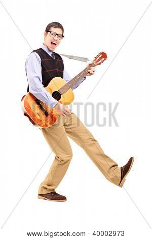 Full length portrait of a happy male playing a guitar isolated against white background