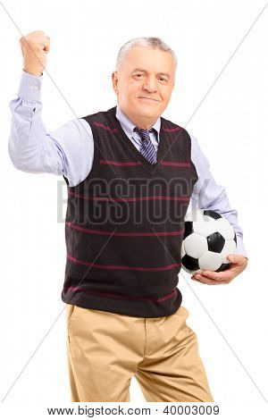 A happy mature fan with football gesturing with his hand isolated against white background