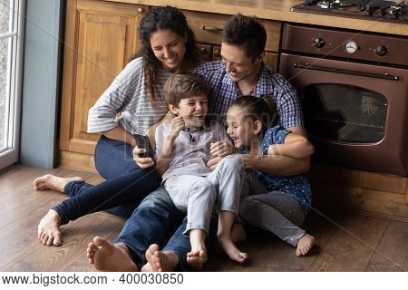 Cute Millennial Kids Parents Tickling On Floor Shooting Funny Video