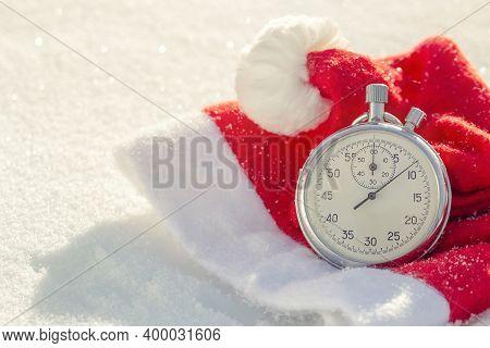 Santa Hat With Stopwatch. Christmas Holidays Celebration Concept. Christmas Card Ideas. Christmas Ba