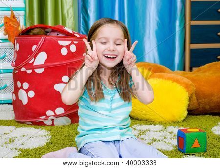 Adorable smiling little girl  at home