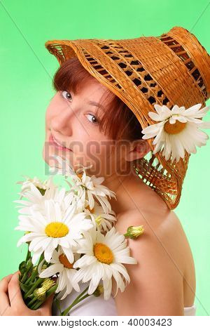 Beautiful Young Girl In The Hat With Chamomile Flowers