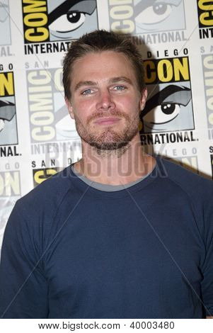SAN DIEGO, CA - JULY 13: Stephen Amell arrives at the 2012 Comic Con convention press room at the Bayfront Hilton Hotel on Friday, July 13, 2012 in San Diego, CA.
