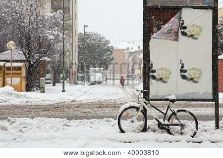 Streets and city road covered with snow during heavy snowfall in Alba, Northern Italy.