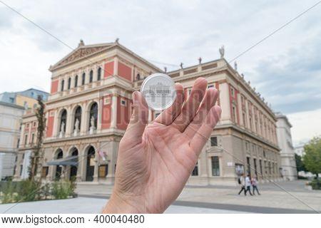 Vienna, Austria - August 30, 2020: Silver Vienna Philharmonic Coin In Hand With Vienna Philharmonic
