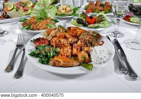 A Magnificent Dining Table And Chicken Shish Kebab In A Luxury Restaurant, Delicious Tavuk Sis Kebab