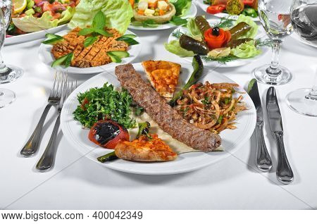 A Magnificent Dining Table And Adana Shish Kebab In A Luxury Restaurant, Turkish Adana Shish Kebab