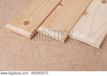 Wooden Slats Lie On A Table Covered With Hardboard.