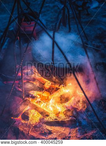 Selective Focus On Boiling Cauldron With Mysterious Decoction On A Campfire At Night Witch Sabbath.