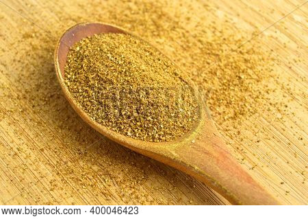 Aromatic Fragrant Organic Cumin Powder Spice, On Bamboo Cutting Board In Wooden Spoon