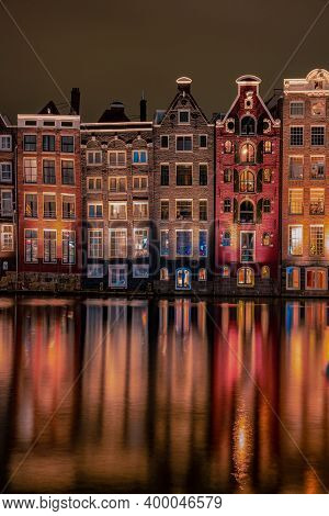 Amsterdam Netherlands Canals With Lights During Evening In December During Wintertime In The Netherl