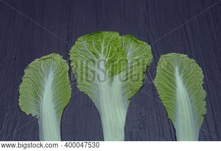 Fresh Peking Cabbage Leaves On A Gray Background.abstraction.