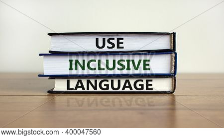 Use Inclusive Language Symbol. Books With Words 'use Inclusive Language' On Beautiful Wooden Table,