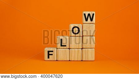 Flow Symbol. Wood Cubes With Word 'flow' Stacking As Step Stair On Beautiful Orange Background, Copy